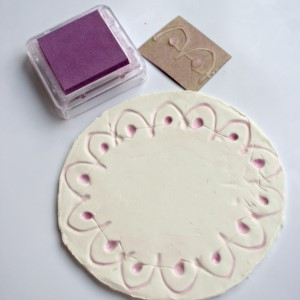 Step 4 - make a clay diya with kids, color the stamp pattern