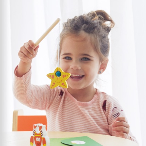 Child with Early Explorers activity